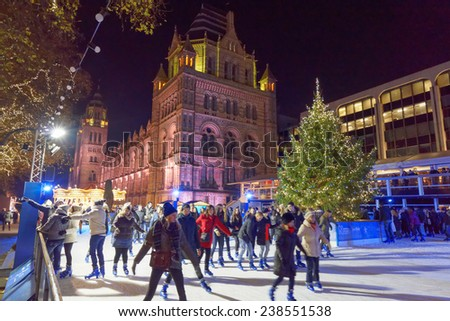 LONDON - DEC 14: National History Museum pictured on the night of December 14th, 2014. The Natural History Museum hosts a christmas tree and ice skating rink, one of the top touristic attraction. - stock photo