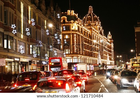 LONDON - DEC 8 : Night View of Harrods with christmas decoration on Dec 8, 2012, London, UK. This department store was opened at 1824 and now it is one of the most famous luxury store in London. - stock photo
