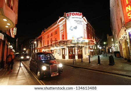 LONDON - DEC 11: Outside view of Ambassadors Theatre, West End theatre, located on West Street, City of Westminster, since 1913, designed by W. G. R. Sprague on Dec 11, 2012 in London, UK