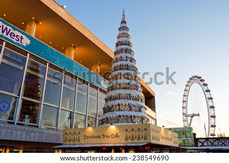 LONDON - DEC 14: The south area and London Eye wheel pictured during Christmas time on Dec 14th, 2014, in London, UK. The London eye is the tallest Ferris wheel in Europe.  - stock photo