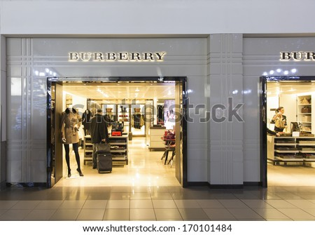 LONDON  DECEMBER 16: A Burberry fashion store December 16, 2013 Heathrow, London, England. Burberry had revenue of £2 billion and £346 million operating profit in the year ended 31 March 2013. - stock photo