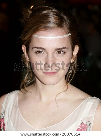 LONDON - DECEMBER 6: Actress Emma Watson attends the red carpet premiere of Harry Potter  December 6, 2005 in London, England. - stock photo