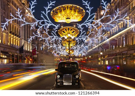 LONDON - DECEMBER 8: Christmas lights on Regent street, the busiest shopping area, on December 8, 2012 in London, England - stock photo