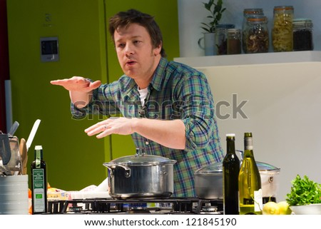 LONDON - DECEMBER 12: Jamie Oliver performs a cooking demo in London, England, on Wednesday, December 12, 2012 - stock photo