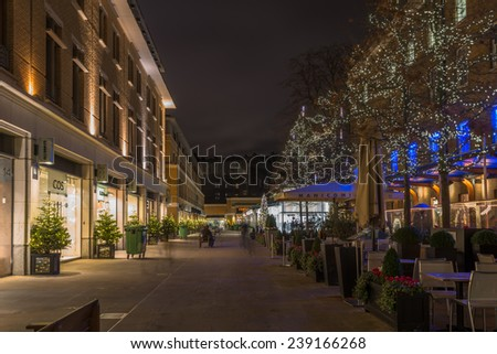 LONDON - DECEMBER 21st 2014: Christmas lights decorations on Duke of York Square offers a range of international retailers and leading restaurant alongside the iconic Saatchi Gallery. - stock photo