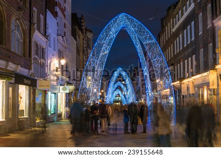 LONDON - DECEMBER 21st 2014: Christmas lights on South Molton Street, in Mayfair in London.The Christmas lights switch on takes place as part of The Lanes of Mayfair Christmas Shopping Extravangza - stock photo