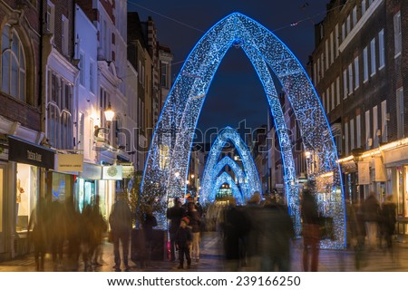 LONDON - DECEMBER 21st 2014: Christmas lights on South Molton Street, in Mayfair in London. The lights will remain in place until the New Year.  - stock photo
