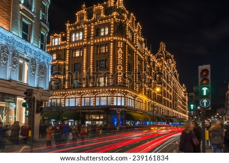 LONDON - DECEMBER 21st 2014: View of Harrods with christmas decorations. The store, formerly owned by Mohamed Al-Fayed, then sold to Qatar Holdings is one of the most famous luxury stores in London.