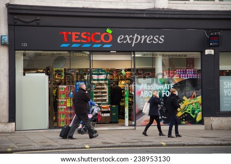 LONDON - DECEMBER 11TH: The exterior of an Tesco's express supermarket on December the 11th, 2014, in London, England, UK. Tesco's is one of the UK's leading supermarkets. - stock photo