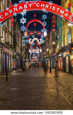 LONDON - DECEMBER 29th 2014: This one of the most famous and popular shopping areas of London celebrates Christmas with some of the most spectacular Christmas lights in the capital.  - stock photo