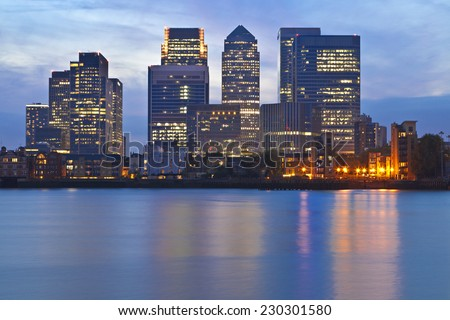 London Docklands business district skyline over Thames river at twilight