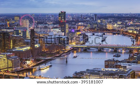 London, England - Aerial skyline view of London with River Thames and famous landmarks at blue hour