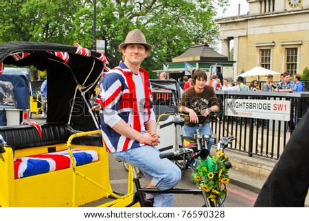LONDON, ENGLAND - APRIL 29: Cab driver wearing T-shirt with flag of UK near Buckingham Palace on the day of the wedding of Prince William on April 29, 2011 in London England - stock photo