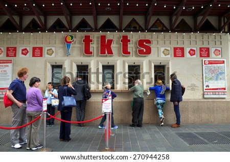 London, England - April 16, 2015: Customers at the TKTS Ticket Office in Leicester Square, London. TKTS sells theater tickets at discounted prices and has operated in Leicester Square since 1980 - stock photo