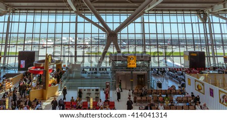 London, England, April 20, 2016: Heathrow Terminal 5 is an airport terminal at Heathrow Airport. Opened in 2008, the main building in the complex is the largest free-standing structure in the UK - stock photo