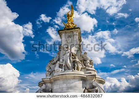 London, England - APRIL 14, 2016: Imperial Memorial to Queen Victoria (1911) in front of Buckingham palace built by Sir Aston Webb.