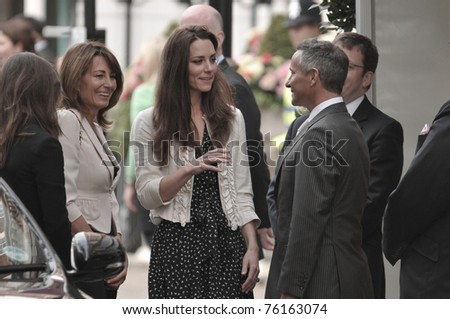 LONDON, ENGLAND - APRIL 28: Kate Middleton (C) arrives with her mother Carole Middleton at the Goring Hotel on the evening before her wedding to Prince William on April 28, 2011 in London England. - stock photo