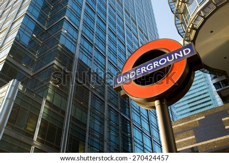 LONDON ENGLAND - APRIL 14, 2015: london underground sign -logo for tube  in the office zone, Canary Wharf.