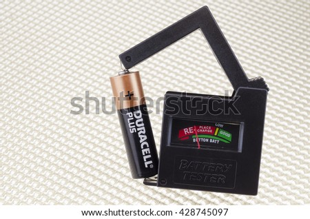 London, England - April 12, 2012: Universal Battery Tester showing a Duracell AA battery being tested and the Charge Rate.