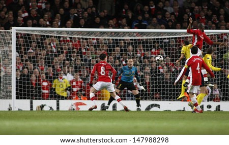 LONDON, ENGLAND. 31/03/2010. Arsenal attack the Barcelona goal during the first half of the  UEFA Champions League quarter-final between Arsenal and Barcelona at the Emirates Stadium - stock photo