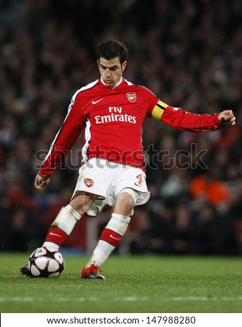 LONDON, ENGLAND. 31/03/2010. Arsenal player Cesc Fabregas (captain) in action during the  UEFA Champions League quarter-final between Arsenal and Barcelona at the Emirates Stadium - stock photo