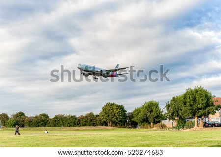 LONDON, ENGLAND - AUGUST 22, 2016: HL8284 Asiana Airlines Boeing 777 Landing in Heathrow Airport, London.