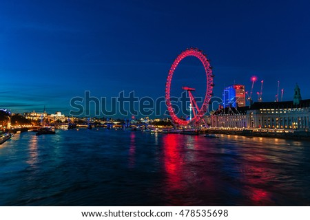 LONDON, ENGLAND - AUGUST 22, 2016: London Thames River and Spinning London Eye. Long Exposure Photo Shoot. Late Evening.