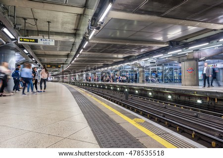 LONDON, ENGLAND - AUGUST 18, 2016: Westminster Underground Station in London, England. Blurry People because of Long Exposure.