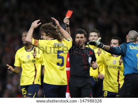 LONDON, ENGLAND. 31/03/2010. Barcelona player Carles Puyol (captain) is shown the red card  during the  UEFA Champions League quarter-final between Arsenal and Barcelona at the Emirates Stadium - stock photo