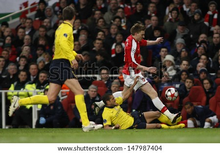 LONDON, ENGLAND. 31/03/2010. Barcelona's Dani Alves and Arsenal player Nicklas Bendtner in action during the  UEFA Champions League quarter-final between Arsenal and Barcelona at the Emirates Stadium - stock photo
