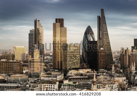 London, England - Business district with famous skyscrapers and landmarks at golden hour - stock photo