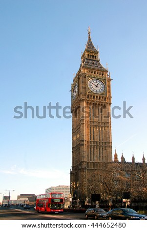 LONDON ENGLAND - DEC 19 2005:  London Buses with Big Ben. The London Bus service is one of the largest urban bus networks in the world with 8,000 buses covering 700 routes.