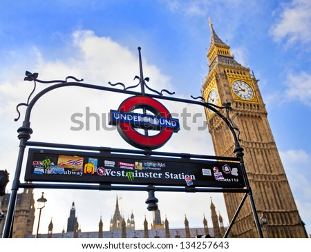 LONDON, ENGLAND Dec 21: London Underground subway sign in front of the famous Big Ben clock at Westminster on December 21, 2012 in London, United Kingdom.