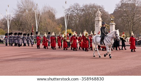 London, England - December 20, 2015 - Changing of the Guard at Buckingham Palace, residence and principal workplace of the reigning monarch of the United Kingdom. - stock photo