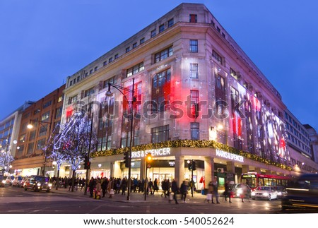 LONDON, ENGLAND - DECEMBER 18, 2016: Christmas decoration in the Oxford Street. The road, located in the City of Westminster, is the Europe's busiest shopping street.
