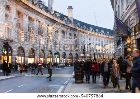 LONDON, ENGLAND - DECEMBER 18, 2016: People walking in the Oxford Street during Christmas time. The road, located in the City of Westminster, is the Europe's busiest shopping street.