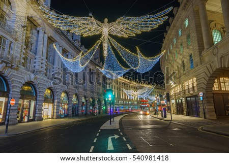 LONDON,ENGLAND - DECEMBER 16,2016: Regent Street with light trails and christmas decoration, central London