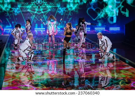 LONDON, ENGLAND - DECEMBER 02: Singer Ariana Grande performs as models walks the runway at the annual Victoria's Secret fashion show on December 2, 2014 in London, England. - stock photo