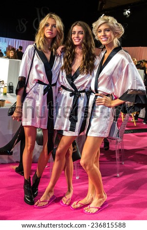 LONDON, ENGLAND - DECEMBER 02: VS models pose backstage at the annual Victoria's Secret fashion show at Earls Court on December 2, 2014 in London, England. - stock photo