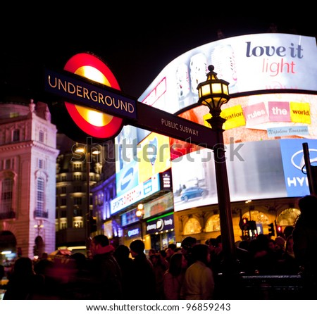 LONDON, ENGLAND FEB 13: Famous Piccadilly Circus neon signage that has become a major attraction of London on Feb 13, 2012 in London, United Kingdom. - stock photo