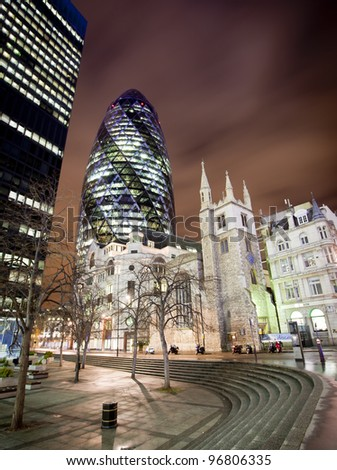 LONDON, ENGLAND FEB 13:The famous Gherkin or Swiss RE building on Feb 13, 2012 in London, United Kingdom. - stock photo