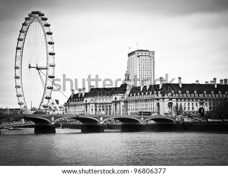 LONDON, ENGLAND FEB 17: View of Westminster Bridge and the favourite tourist attraction the London Eye on Feb 17, 2012 in London, United Kingdom. - stock photo
