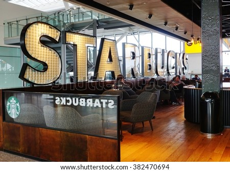 LONDON, ENGLAND -3 FEBRUARY 2016- A Starbucks coffee shop at London Heathrow Airport (LHR). Starbucks has had a presence in the United Kingdom since 1998.