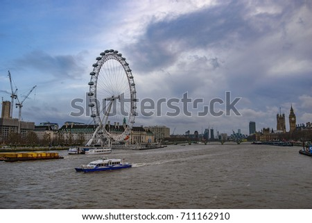 LONDON - ENGLAND, FEBRUARY 2017: Urban cityscape view of  London city against a cloudy sky in winter. London, United Kingdom.