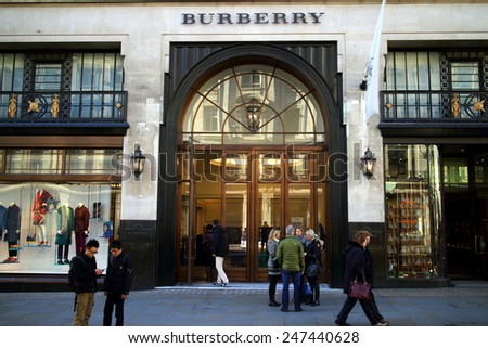 London, England - January 24, 2015: People in front of and entering the Burberry flagship store in Regent Street, London. The brand was founded by Thomas Burberry in 1856 - stock photo