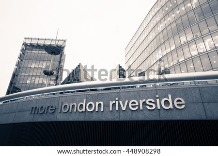 LONDON, ENGLAND - JANUARY 01,2016. The Sign more London Riverside with buildings in the background. Black and white photo. - stock photo