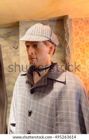 LONDON, ENGLAND - JUL 22, 2016: Character from the stories at the Sherlock Holmes Museum, 221 Baker Street, London. Sherlock Holmes  is a fictional private detective created by Sir Arthur Conan Doyle