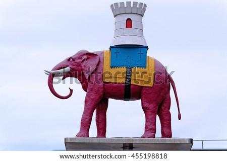LONDON, ENGLAND - JULY 8, 2016: Elephant and Castle symbolic statue, in front of Elephant and Castle Shopping center, South London, UK - stock photo