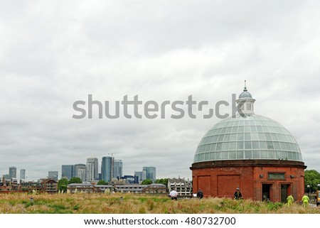 LONDON, ENGLAND - JULY 8, 2016: Entrance to the Greenwich foot tunnel, southern side, with a view of Canary Wharf.