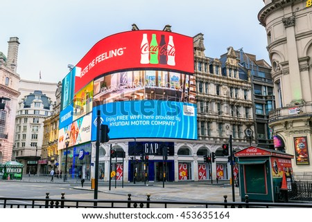 LONDON, ENGLAND - JULY 16, 2016. Famous Piccadilly Circus neon signage shines. These signs have become a major attraction of London in United Kingdom.